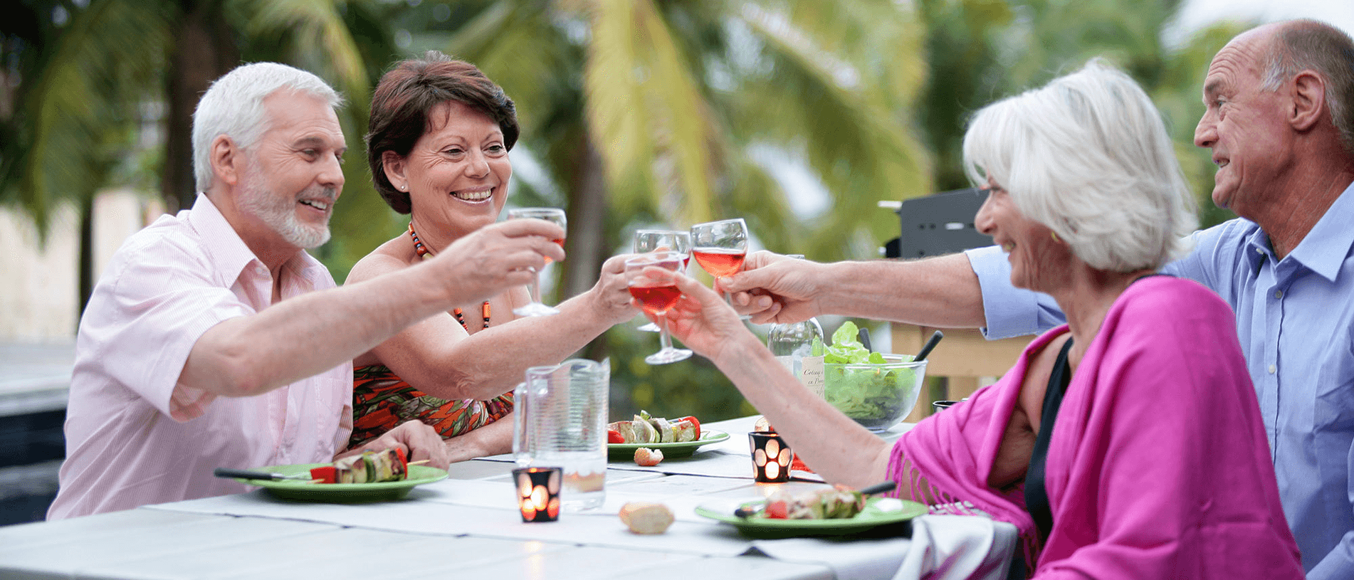 group-of-retirees-having-a-drink-celebrating